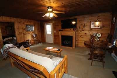 Tall Pines - Spacious living room with leather recliner, queen size futon, gas fireplace and big screen tv
