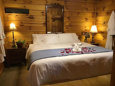 Tall Pines Bedroom 1 - King size bed on a handcrafted base equipped with USB ports, plugs and mood lighting. Luxury bedding, pillows and robes!