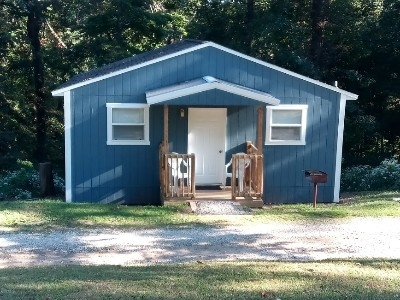 The Blue Spruce Cabin - The recently renovated Blue Spruce Cabin previously Cabin 3, is tucked right up again the surrounding trees.  It offers you a taste of nature while enjoying your getaway to the Hocking Hills.