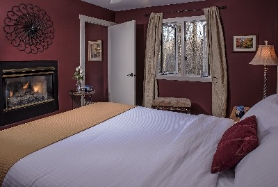 The Sinclair Croft - The Sinclair Croft bedroom with see-through fireplace