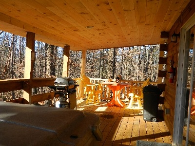 The Landing - Large wrap around deck with table and chairs, hot tub and gas grill.  Great view of the forest.
